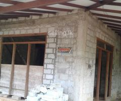 Land and half finish house for sell