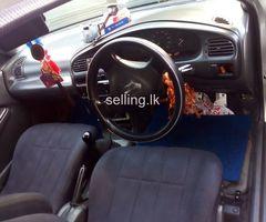 Mazda - Familia 323