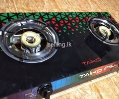 Gas cooker with glass top
