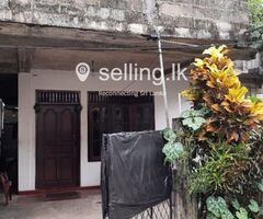Land with a two story house for sale in Dehiwala