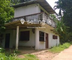 Land with house and shop around Kandy