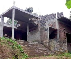 Partly build House with 27.75 Purchase land in kandy