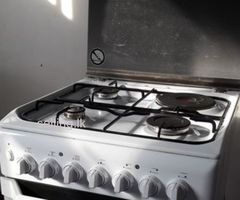 Indesit electric oven with burners